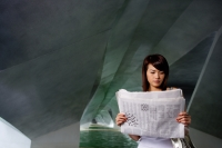 Woman in tunnel, reading newspaper - Yukmin