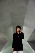 Businesswoman in black jacket, using mobile phone - Yukmin