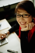 Woman with dark glasses, smiling at camera - Nugene Chiang