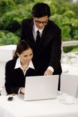 Businesspeople using laptop - Yukmin
