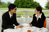Businesspeople in restaurant, having a discussion - Yukmin
