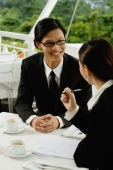 Two executives in restaurant, having a discussion - Yukmin