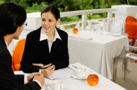 Businesspeople in restaurant, talking - Yukmin