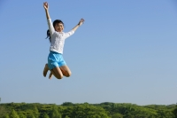 Girl jumping in mid air - Alex Mares-Manton