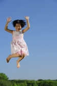 Girl in pink dress, jumping in mid air, smiling at camera - Alex Mares-Manton