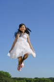 Girl wearing white dress, jumping in mid air - Alex Mares-Manton