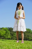 Girl wearing white dress, holding bouquet of flowers - Alex Mares-Manton