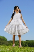 Girl in white dress, smiling at camera - Alex Mares-Manton