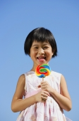 Girl licking lollipop, portrait - Alex Mares-Manton