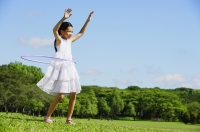 Girl in park using hoola hoop - Alex Mares-Manton