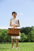 Girl in white dress, holding picnic basket - Alex Mares-Manton