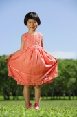 Girl in peach dress, standing in park - Alex Mares-Manton