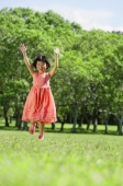 Girl running towards camera, arms outstretched, smiling - Alex Mares-Manton