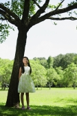 Girl in park, standing under tree - Alex Mares-Manton