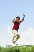 Man jumping in mid air, pointing at camera - Alex Mares-Manton