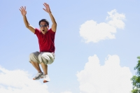 Man jumping in mid air, arms outstretched, mouth open - Alex Mares-Manton
