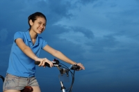 Woman on bicycle - Yukmin