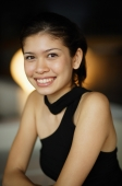 Young woman smiling at camera, portrait - Yukmin