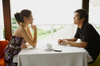 Couple in restaurant, talking - Yukmin