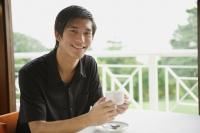Man in cafe having coffee - Yukmin