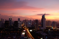 Sunset view of the CBD, with building construction and skyscrapers along Jalan Jend Sudirman - Martin Westlake