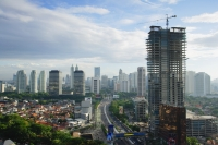 Late afternoon view of the CBD and skyscrapers along Jalan Jend Sudirman, Jakarta - Martin Westlake