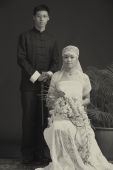 Old fashioned studio portrait of bride and groom - Alex Mares-Manton