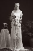 Woman in wedding gown, looking at camera, portrait - Alex Mares-Manton