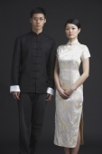 Couple dressed in traditional Chinese attire, posing for studio portrait - Alex Mares-Manton