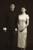 Man and woman dressed in traditional Chinese attire, posing for studio portrait - Alex Mares-Manton