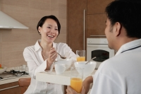 Couple sitting in kitchen, having breakfast - blueduck