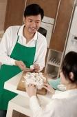 Couple in kitchen kneading dough - blueduck