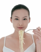 Young woman eating spaghetti - blueduck