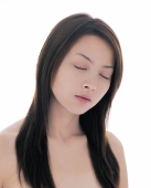 Young woman with long straight hair, eyes closed - blueduck