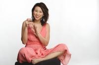 Woman applying nail polish on fingers - Yukmin