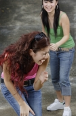 Two teenage girls laughing - Yukmin