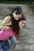 Teenage girl carrying another girl on her back - Yukmin