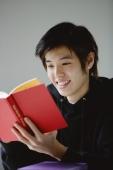 Young man reading book - Yukmin
