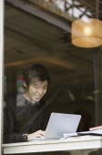 Young man using laptop - Yukmin