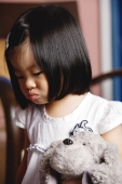 Young girl holding stuffed toy - Yukmin