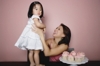 Mother carrying young girl - Yukmin