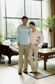 Couple standing in living room, looking at camera - blueduck