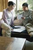 Couple at home doing finances - blueduck