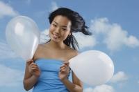 Woman holding two  white balloons - Yukmin
