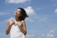 Woman in white top, smiling, looking away - Yukmin