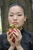 Young woman holding dragon fruit - Yukmin