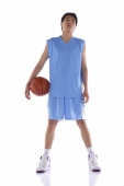 Young man standing with basketball - blueduck