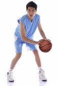 Young man with basketball - blueduck