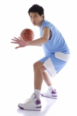 Young man playing basketball - blueduck