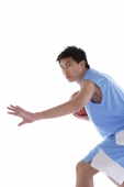 Young man playing basketball, arm outstretched - blueduck